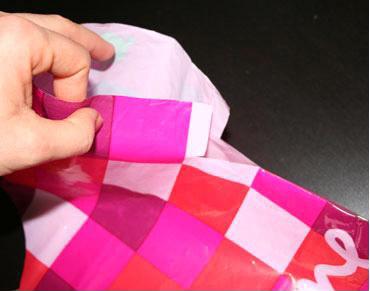 grembiulino-delantal con bolsas de plástico