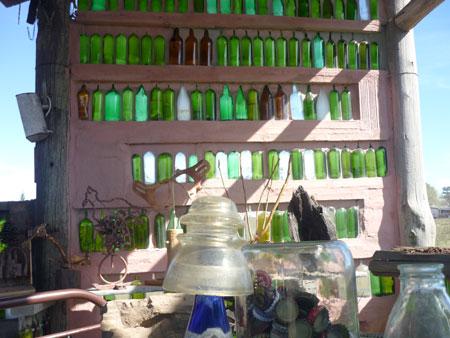 Muros con botellas de vidrio por Hector