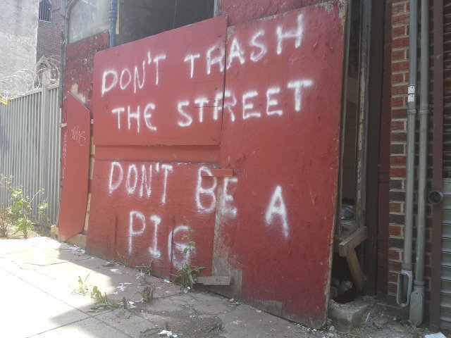 Dont trash the street, dont be a pig -Michael Jastremski for openphoto.net